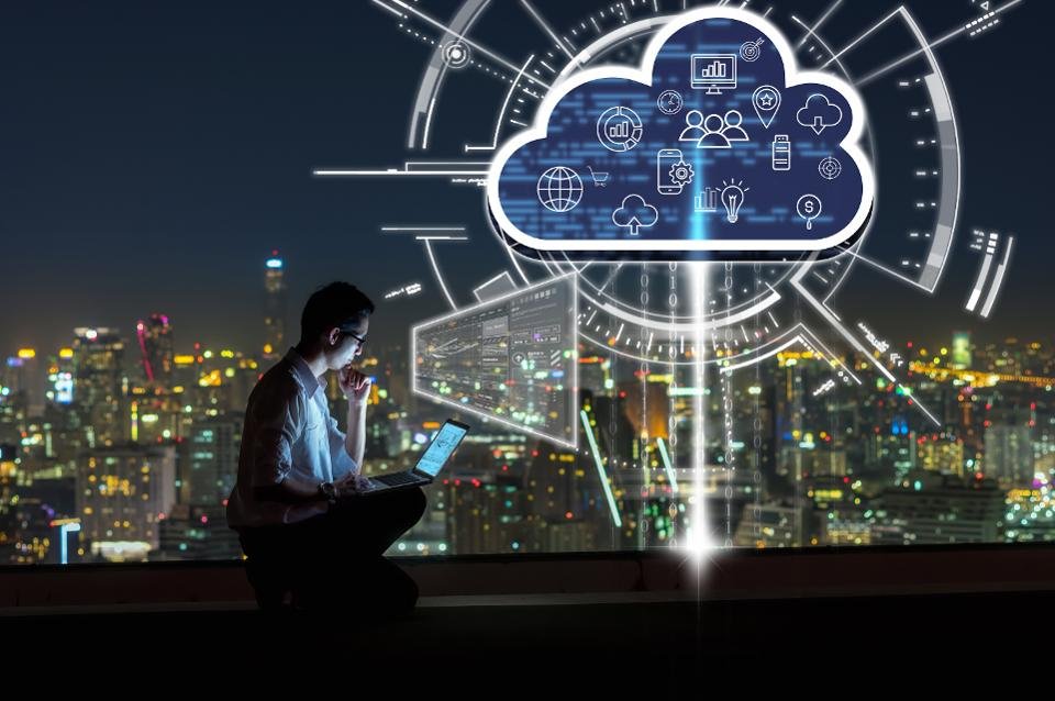 A person working on his lap and shows cloud computing